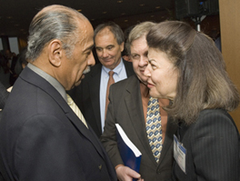 LSC President Helaine M. Barnett speaks with Rep. Conyers. Picture Copyright American Bar Association.