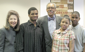 Maryland Chief Judge Robert M. Bell, center, stands with (from left to right) LSC President Helaine M. Barnett, and Annapolis Road Academy students James Stapleton, Ebony Milligan and Michael McComb.