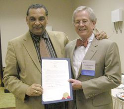Wilmington Mayor James M. Baker, left, presents a proclamation in appreciation of LSC and its Delaware grantee to LSC Board Chairman Frank B. Strickland.