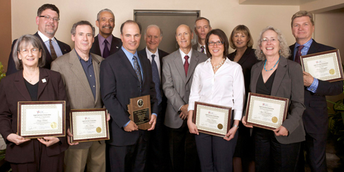 Left to Right: Pro bono awardees Gina Kalish, Todd Lang and Marc Kalish; LSC Board Member Robert J. Grey Jr.; Judge Joseph Kreamer, Maricopa County Superior Court; LSC Board Chairman John G. Levi; Justice John Pelander, Arizona Supreme Court; LSC Board Member Victor B. Maddox; awardee Laura Bergland; LSC Board Member Sharon L. Browne; awardees Alyce Pennington and Dean Christoffel. Photos by Dan Stein.