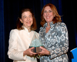 Barnett, left, receives her award from Roberta D. Liebenberg, chair of the ABA Commission on Women in the profession.