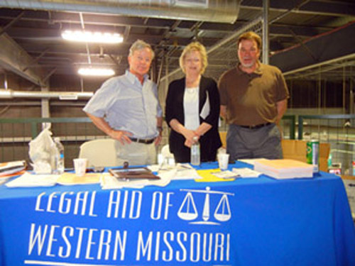 Janice Franklin (center), Managing Attorney at the Legal Aid of Western Missouri Joplin Office, standing with volunteer attorneys, Ron Bodison (left) and Bill Hays (right) of the law firm Shook Hardy & Bacon.