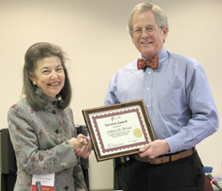LSC President Helaine M. Barnett receives her five-year service award from LSC Board Chairman Frank B. Strickland.