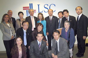 LSC President Helaine M. Barnett (back row, center), and LSC's Treefa Aziz and John Constance (far left) stand with members of the Japan Federation of Bar Associations.