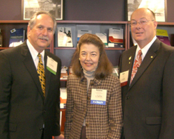 LSC President Helaine M. Barnett stands with Laurence M. Rose (left), President and CEO of NITA, and Mark Caldwell, Director of Specialty Programs for NITA.