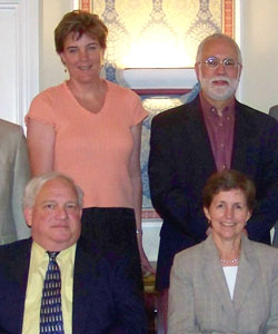 Standing: Victoria A. Coyle, executive director of North Penn Legal Services, and Victor M. Fortuno, president of LSC. Sitting: Harvey F. Strauss and Elizabeth Fritsch, co-executive directors of Legal Aid of Southeastern Pennsylvania.