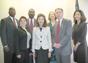 LSC President Helaine M. Barnett (front row, second from left) stands beside Kevin M. Brown, Chief Operating Officer of the American Red Cross. Joining them (from left) are LSC staff Arthur Ford, Mattie Cohan, and Willie Abrams, and Red Cross staff Mary DeWitt-Dia and Juliet K. Choi.