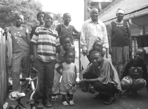 Benjamin Havyarimana with wife Anelise (standing, right) and family.