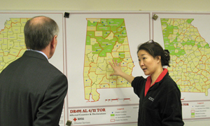 Ms. Choi briefs Mr. Sandman on the response to the tornado outbreak in the South.