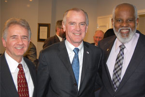 LSC President James J. Sandman (center) stands with Warren Oliveri (left) and Wilhelm Joseph, president and executive director, respectively, of Maryland's Legal Aid Bureau.