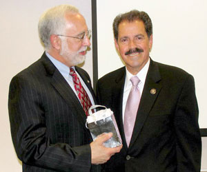 Congressman Jos E. Serrano (right) and LSC President Victor M. Fortuno at LSC's Hispanic Heritage Month celebration.