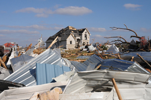 Tornado-damaged house surrounded by rubble in Lafayette, Tenn. Image courtesy Federal Emergency Management Agency.