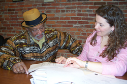 Katie Laskey-Donovan consults with a client who came to the Legal Aid Society of Cleveland's Wage Project for help.